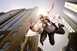 12306206-Businessman-falling-from-a-tall-building-Stock-Photo